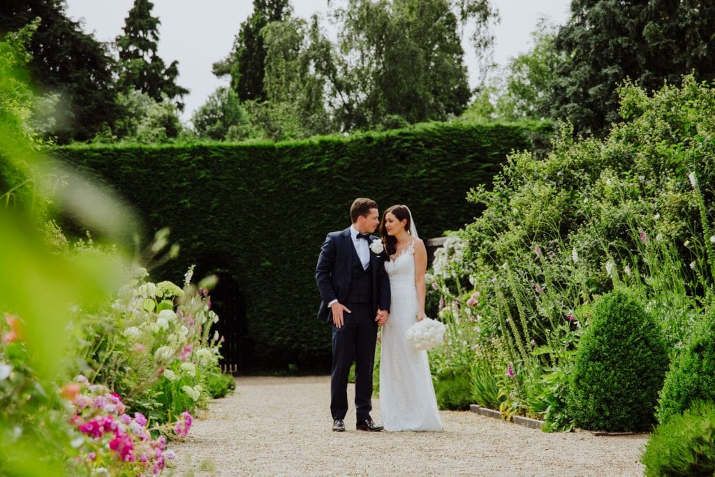 bride and groom at gayness park in the gardens
