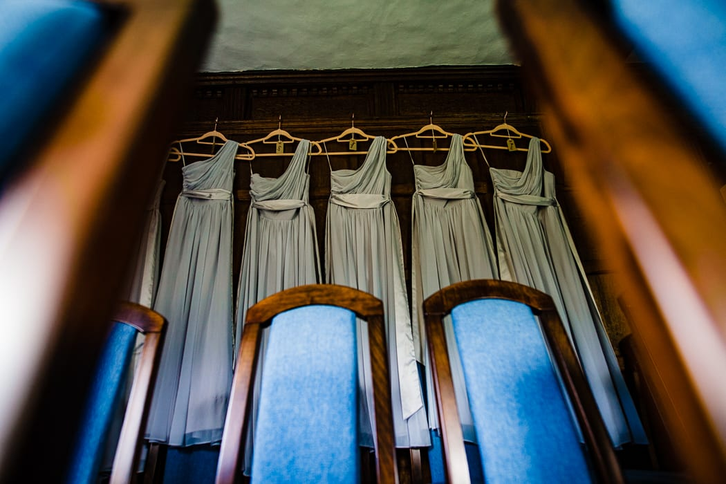 bridesmaids dresses hanging on a wall