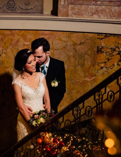 winter wedding couple on staircase