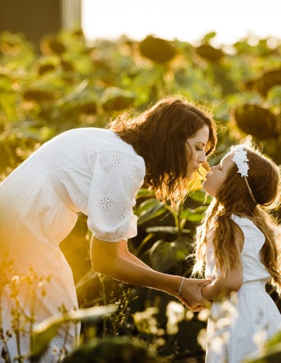 sunflower photoshoot of mother and daughter