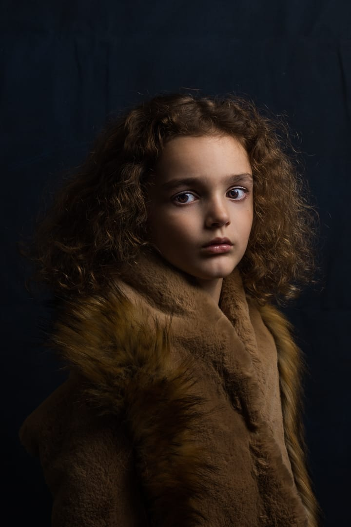 childrens photography of young boy with curly hair and tan coloured coat