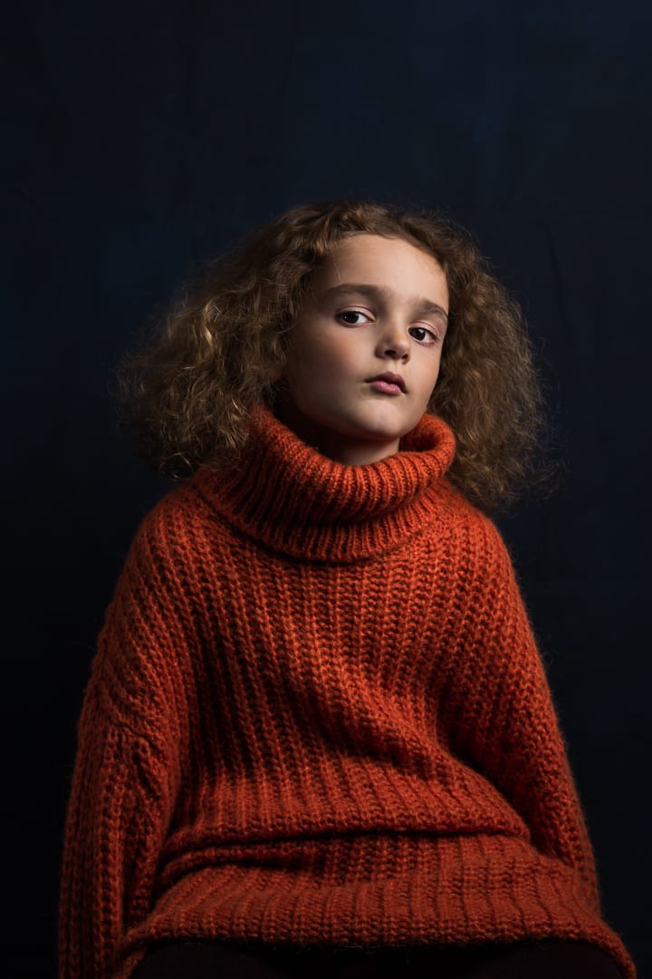 childrens photoshoot of boy with orange jumper and wild hair