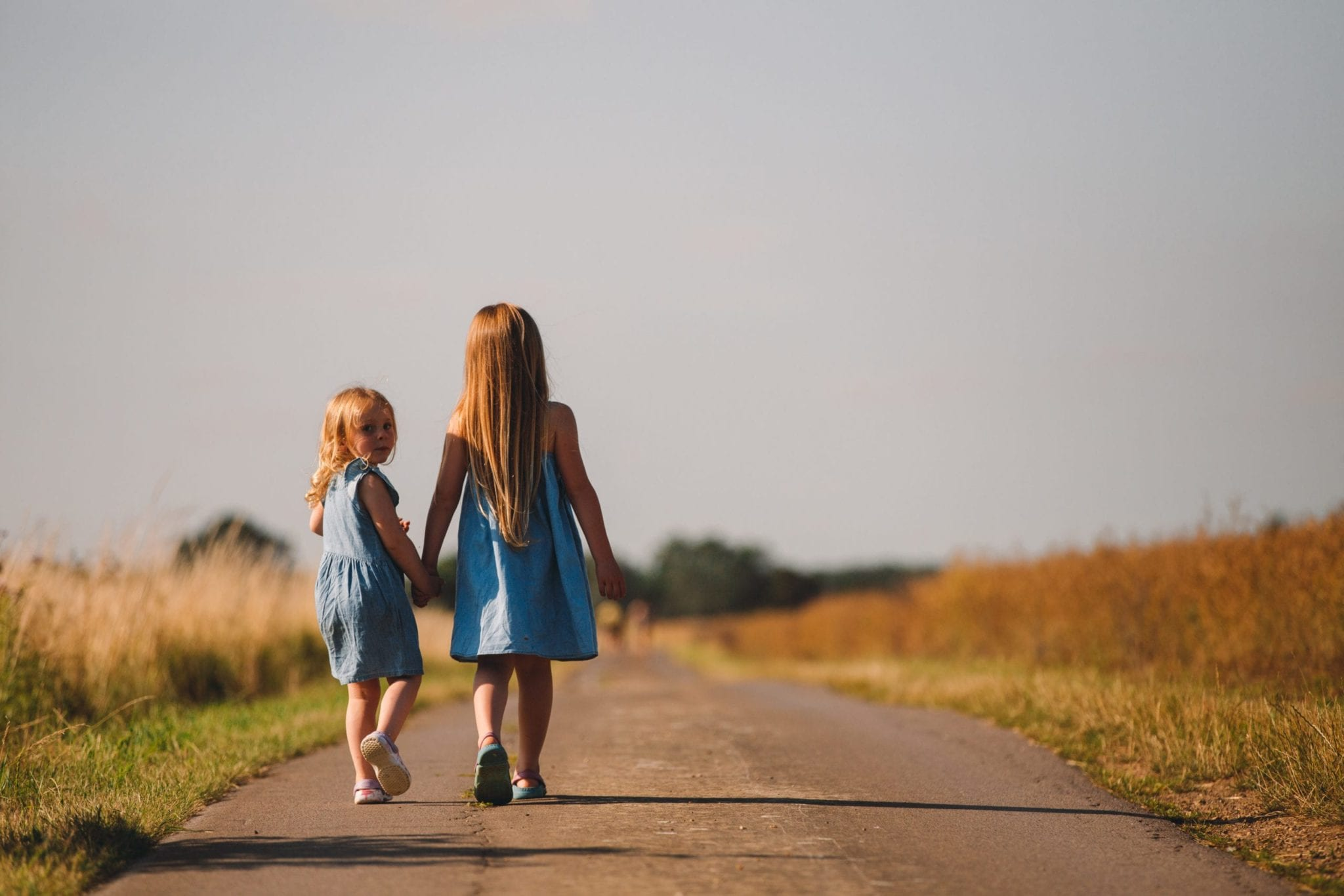 two girls walking down the road