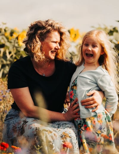 mum and daughter in sunflowers